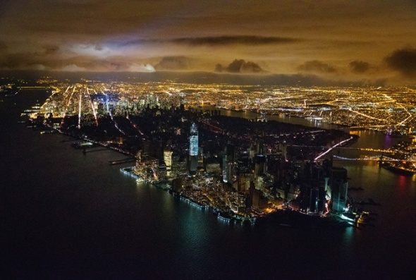 Photograph by Iwan Baan, Reportage by Getty Images In Manhattan, Sandy's surging tide knocked out a Con Ed substation, darkening the city below Midtown. Private generators provided some light, including the blue glow of the new World Trade Center, whose base is three feet above sea level.